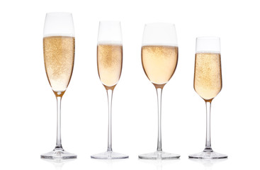 Champagne glasses with bubbles on white