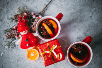christmas hot mulled wine with spices and traditional New Year decorations on light background