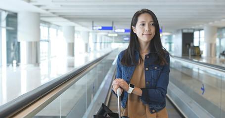Woman taking the travelator in Hong Kong airport