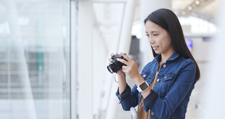 Traveler woman taking photo with camera