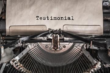 Testimonial message typed on old vintage typewriter. Close up.