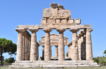 The Legacy of Time /Well-preserved antique temple against the background of a bright blue sky