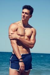 Beautiful bodybuilder on the beach