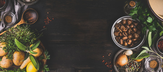 Chestnuts cooking ingredients on dark rustic background, top view, place for text. Seasonal food and eating. Banner Wall mural