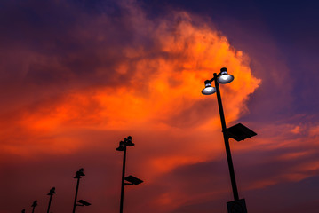 Lamp post silhouette with sunset sky.