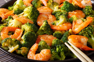 stir fry shrimp with broccoli and garlic macro. horizontal