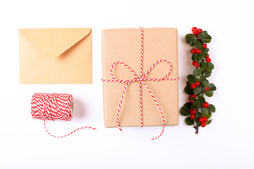 Christmas gift  box collection with envelope, ribbon, red berries for mock up template design. View from above. Flat lay, copy space.