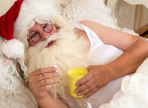 Santa Claus taking medicine