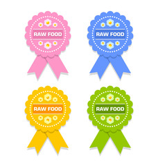 Colorful raw food rosettes on white background
