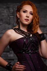 Portrait of ginger woman in black dress