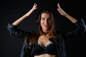 Picture of young brunette wearing headphones