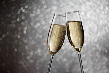 Picture of two wine glasses with champagne on gray background