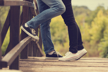 Couple in love standing on the wooden board.