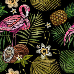 Embroidery flamingo , palm tree leaves, pineapple, coconut tropical seamless pattern. Fashionable template for design of clothes. Embroidery pink flamingos, tropical summer fashion background