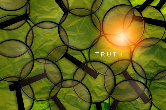truth word with magnifying glass search on word with green paper background