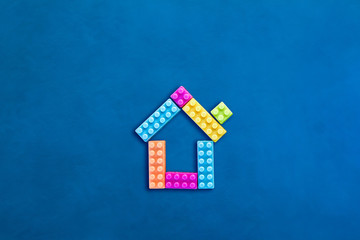house plastic toy on leather background home sweet home ideas concept with free copyspace for your creativity ideas text