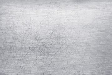bright metal background, polished steel texture with scratches