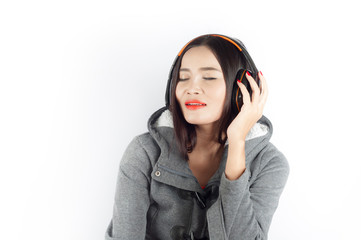 Beautiful asian girl from Thailand sing song from Headphones on white background