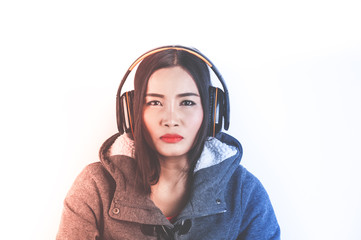 Beautiful asian girl from Thailand listen music from Headphones on white background with Red and blue light side color effect