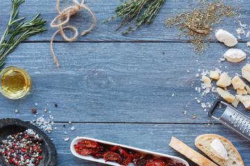 Italian cuisine ingredients background on blue rustic wood, copy space