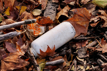 Plastic and glass bottles thrown away and left in nature, pile of garbage. Unecological, ecology, recycling industry, not ecology, recycled material, pollution, neglect, environmental protection.