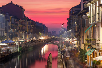 Bridge across the Naviglio Grande canal at sunset, Milan, Lombardia, Italy