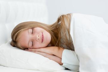 Beautiful teen girl sleeping in bed