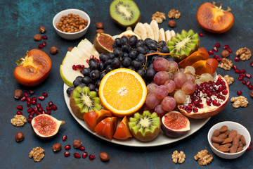 platter with fresh fruits and nuts