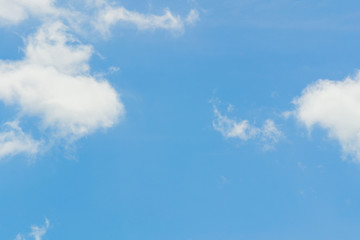 Blue sky background with tiny clouds. White fluffy clouds in the blue sky