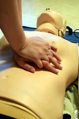 CPR training with CPR dummy. First aid resuscitation concept.
