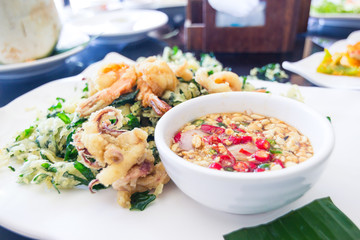 Fried shrimp and squid with herb.