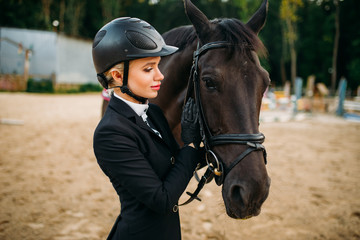Equestrian sport, female jockey and horse face