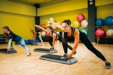 Women group on step aerobic training