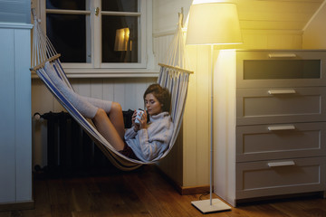 Woman relaxing with a cup of hot drink