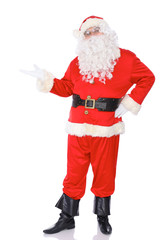 Santa Claus standing with a welcome gesture isolated on white background. Full length portrait