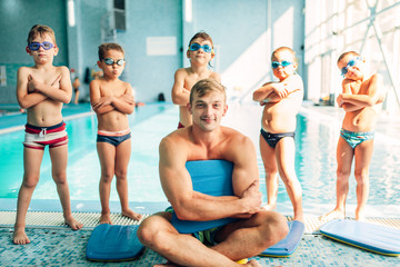 Portrait of male instructor with children