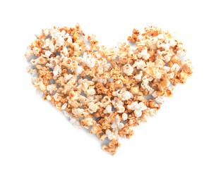 Heart made of tasty caramel popcorn on white background
