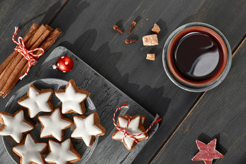 Top view on Christmas cookies, mulled wine, spices and decorations