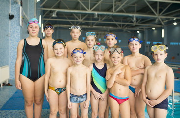 Group of children near a swimming pool
