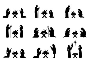 Jesus and Mary pray on their knees in the manger.