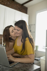 Lesbian couple using laptop together