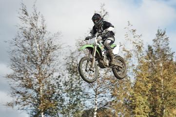 Motorcycle rider flying at motocross