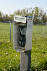 Outdoor telephone booth in a grassy field