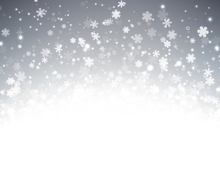 Grey winter background with snowflakes.
