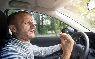 Angry Italian driver gesturing funny, road rage theme
