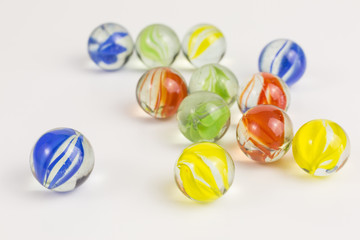 group of glass marbles in various colors