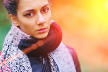 brown-eyed brunette girl in Park in autumn day.