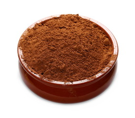 pile cocoa powder and clay bowl isolated on white background