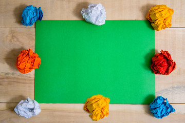 paper colorful balls on a green background