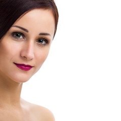 Portrait of a beautiful young woman on a white background. Photo closeup